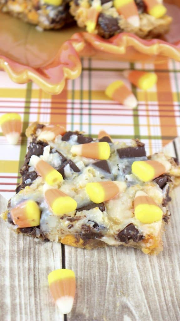 candy corn and chocolate pieces baked into square cookie bars