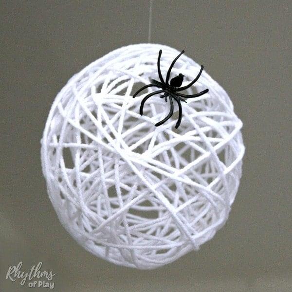 DIY Halloween Decor Idea with handmade spider web egg sack and fake spider