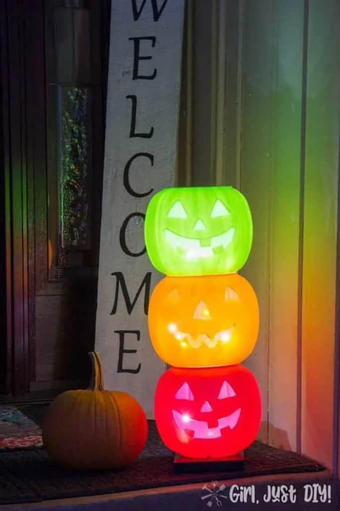 DIY Halloween Porch Ideas with plastic pumpkins and lights inside