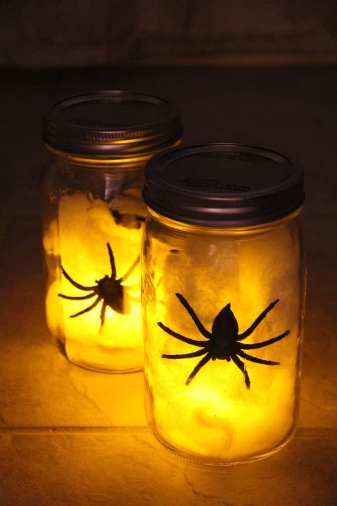 mason jar with cottonballs and fake spiders inside